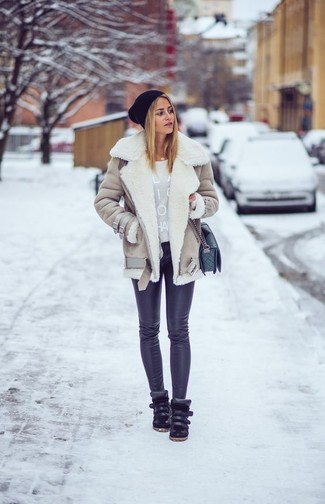 How to wear: black leather high top sneakers, black leggings, grey print crew-neck sweater, beige shearling jacket