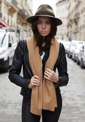How to wear: olive wool hat, black leggings, white crew-neck t-shirt, black leather biker jacket