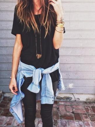 How to wear: gold bracelet, black leather leggings, black crew-neck t-shirt, light blue denim shirt