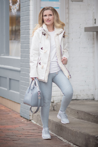 How to wear: grey athletic shoes, grey leggings, white crew-neck t-shirt, white duffle coat