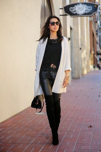 How to wear: black suede over the knee boots, black leather leggings, black lace crew-neck t-shirt, white knit open cardigan