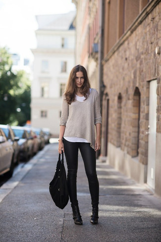 How to wear: black leather ankle boots, black leather leggings, white crew-neck t-shirt, beige oversized sweater