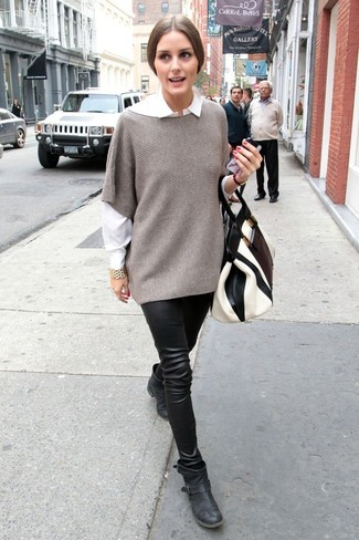How to wear: black leather ankle boots, black leather leggings, white dress shirt, grey poncho