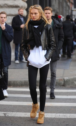 How to wear: tan leather high top sneakers, black leggings, white hoodie, black leather biker jacket