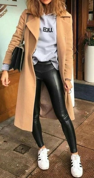 How to wear: white and black leather low top sneakers, black leather leggings, grey print hoodie, camel coat