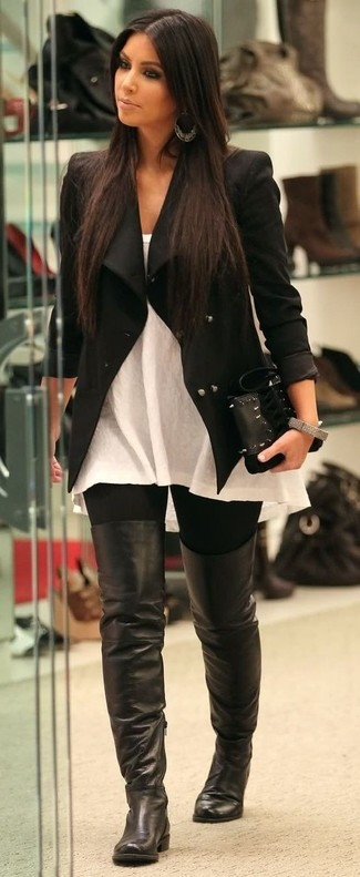 How to wear: black leather over the knee boots, black leggings, white sleeveless top, black biker jacket