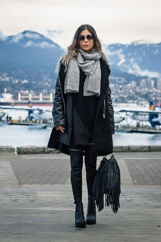 How to wear: black chunky leather ankle boots, black leather leggings, black sweater dress, black boucle coat