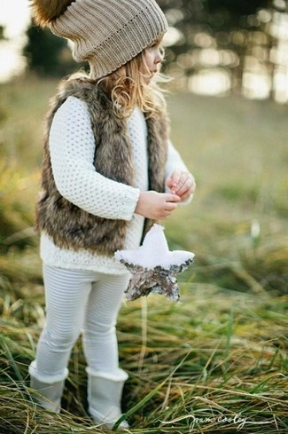 How to wear: grey boots, white leggings, white sweater, brown fur vest
