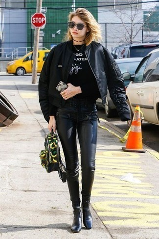 How to wear: black leather ankle boots, black leather leggings, black and white print sweatshirt, black bomber jacket