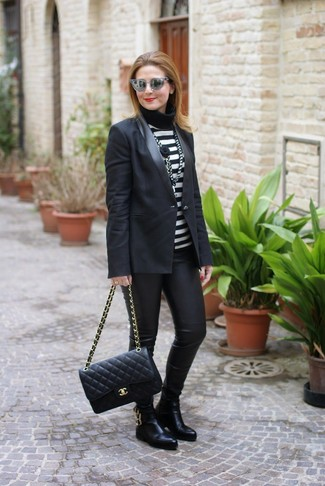 How to wear: black leather chelsea boots, black leather leggings, black and white horizontal striped turtleneck, black blazer