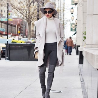 How to wear: grey suede over the knee boots, charcoal leggings, beige turtleneck, beige coat