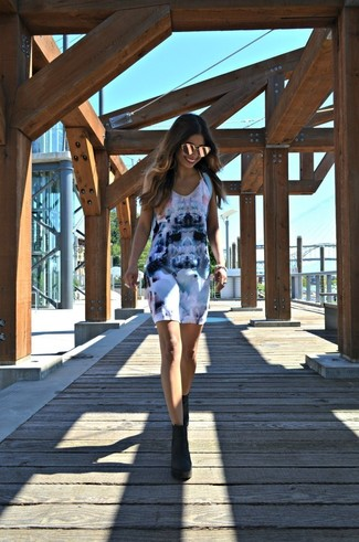How to wear: gold sunglasses, light blue backpack, black suede ankle boots, white print tank dress