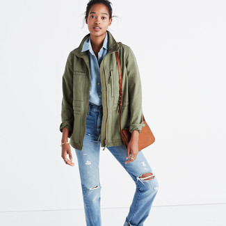 How to wear: tan leather crossbody bag, light blue ripped boyfriend jeans, light blue chambray dress shirt, olive military jacket