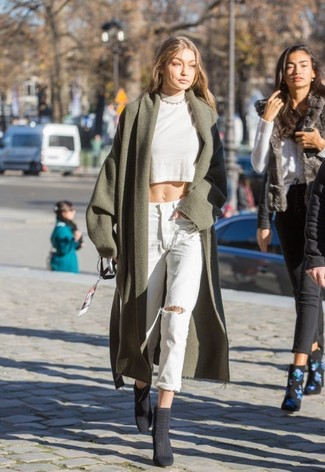 How to wear: charcoal suede ankle boots, light blue ripped boyfriend jeans, white cropped sweater, olive coat