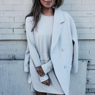 How to wear: light blue coat, grey shift dress, silver earrings