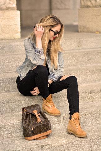 To create an outfit for lunch with friends at the weekend team a light blue denim jacket with black destroyed skinny jeans. Round off this look with camel suede lace-up flat boots.