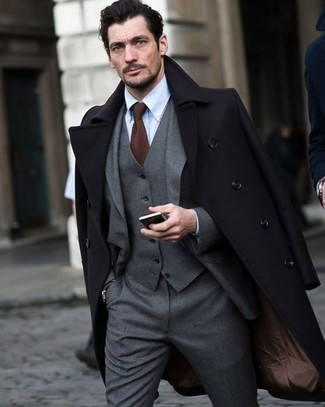 How to wear: brown knit tie, light blue dress shirt, grey three piece suit, black overcoat
