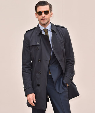 How to wear: olive knit tie, light blue vertical striped dress shirt, navy suit, black trenchcoat