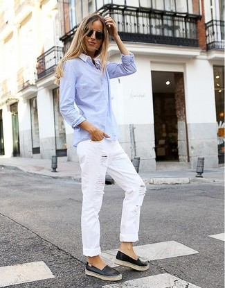 A light blue dress shirt and white ripped boyfriend jeans are a great outfit formula to have in your arsenal. Black leather slip-on sneakers are an easy choice here. A look like this is perfect for awkward transition weather.