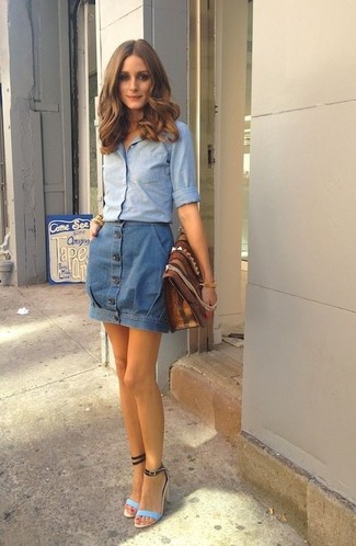 How to wear: brown leather clutch, light blue leather heeled sandals, blue denim button skirt, light blue chambray dress shirt