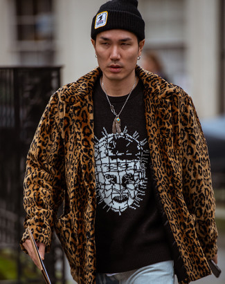 How to wear: black beanie, light blue jeans, black and white print crew-neck sweater, brown leopard fur coat