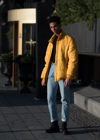 How to Wear Light Blue Jeans For Men: Pair a yellow puffer jacket with light blue jeans to pull together a sleek and elegant getup. Black leather casual boots are a goofproof footwear style that's full of personality.