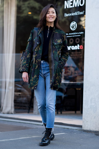How to wear: black leather lace-up flat boots, light blue jeans, black turtleneck, dark green camouflage parka