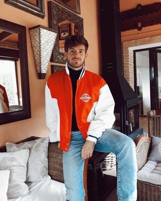 How to wear: light blue jeans, black turtleneck, orange varsity jacket