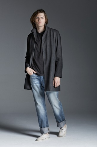 How to wear: white canvas low top sneakers, light blue jeans, charcoal crew-neck t-shirt, charcoal overcoat