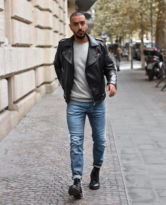 How to wear: black leather casual boots, light blue jeans, grey crew-neck sweater, black leather biker jacket