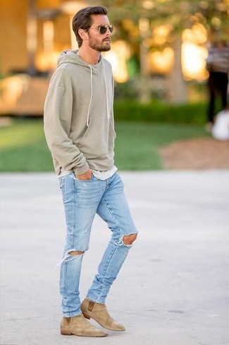 How to wear: tan suede chelsea boots, light blue ripped jeans, grey crew-neck t-shirt, olive hoodie
