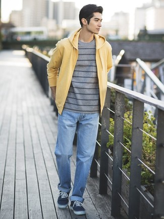 How to wear: navy canvas low top sneakers, light blue jeans, grey horizontal striped crew-neck t-shirt, yellow hoodie