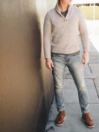 How to wear: brown leather work boots, light blue jeans, grey v-neck t-shirt, beige shawl-neck sweater