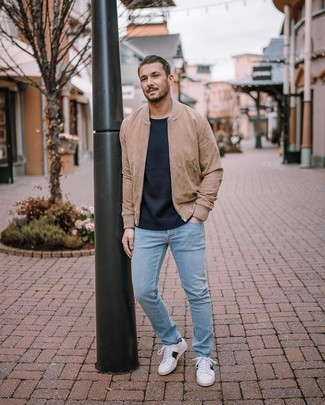 How to wear: white low top sneakers, light blue jeans, navy crew-neck sweater, tan suede bomber jacket