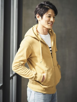 How to Wear a Tan Hoodie For Men: This laid-back combination of a tan hoodie and light blue jeans is capable of taking on different nuances according to the way you style it out.