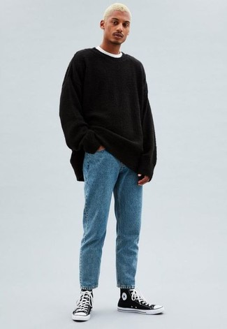 How to Wear a Black Crew-neck Sweater For Men: A black crew-neck sweater and light blue jeans are a cool getup worth incorporating into your off-duty fashion mix. A pair of black and white canvas high top sneakers adds a more laid-back aesthetic to the outfit.