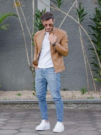 How to wear: white leather low top sneakers, light blue jeans, white crew-neck t-shirt, tan leather bomber jacket