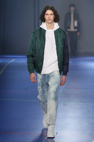 How to wear: white high top sneakers, light blue acid jeans, white hoodie, dark green bomber jacket