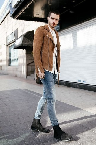 How to Wear Chelsea Boots For Men: This edgy pairing of a brown suede biker jacket and light blue ripped jeans is very easy to put together without a second thought, helping you look sharp and prepared for anything without spending too much time searching through your wardrobe. Get a bit experimental on the shoe front and lift up this look by rounding off with a pair of chelsea boots.
