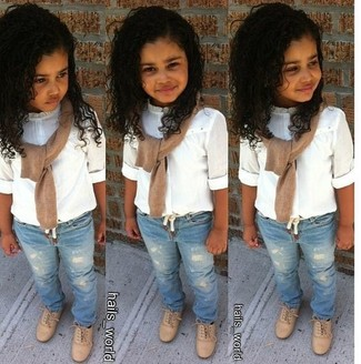 How to Wear a Tan Sweater For Girls: Help your little girl look fashionable by suggesting that she wear a tan sweater with light blue jeans. Complete this getup with tan oxford shoes.