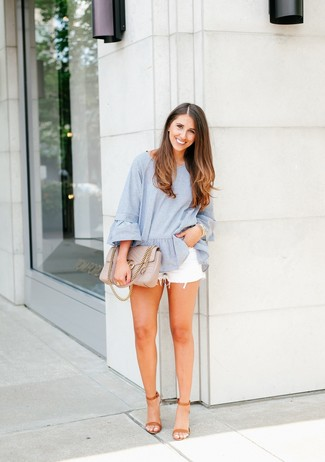 How to wear: light blue vertical striped long sleeve blouse, white denim shorts, tan leather heeled sandals, beige quilted leather satchel bag