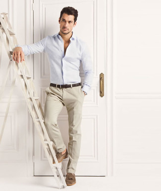 David Gandy wearing Light Blue Long Sleeve Shirt, Beige Dress Pants, Brown Suede Tassel Loafers, Dark Brown Woven Leather Belt