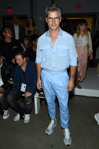 How to Wear Pants For Men: Why not choose a light blue silk long sleeve shirt and pants? As well as super functional, both of these items look amazing when combined together. For something more on the classier end to round off your outfit, introduce light blue low top sneakers to this outfit.