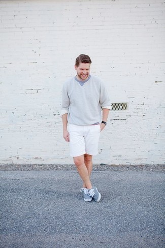 Men's Looks & Outfits: What To Wear Casually: For a laid-back and cool ensemble, team a light blue crew-neck sweater with white shorts — these pieces go really good together. Complement your look with light blue canvas low top sneakers for extra style points.