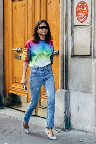 How to wear: black sunglasses, light blue canvas pumps, blue jeans, multi colored tie-dye crew-neck t-shirt