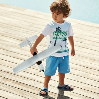 Boys' Looks & Outfits: What To Wear In a Relaxed Way: Choose a white print t-shirt and light blue shorts for your little angel for a fun day in the park. As far as footwear is concerned, suggest that your little man throw in a pair of light blue sandals.