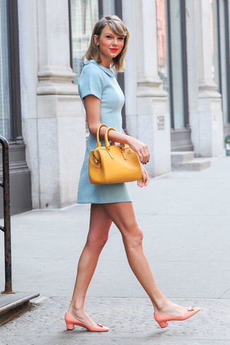 Taylor Swift wearing Light Blue Skater Dress, Orange Leather Pumps, Yellow Leather Tote Bag