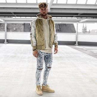 How to wear: tan high top sneakers, light blue ripped skinny jeans, beige hoodie, gold nylon bomber jacket