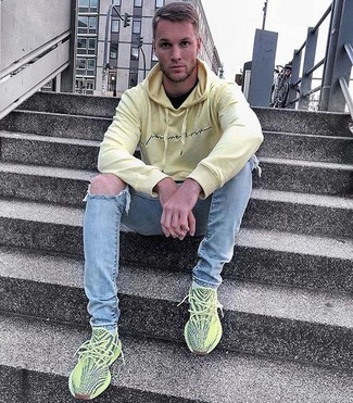 How to wear: green-yellow athletic shoes, light blue ripped skinny jeans, black crew-neck t-shirt, yellow hoodie