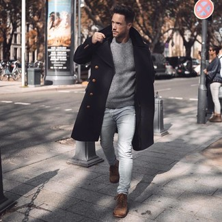 How to wear: brown suede casual boots, light blue skinny jeans, grey crew-neck sweater, black overcoat